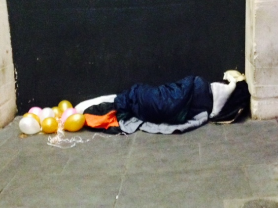 rough sleeper with ballons